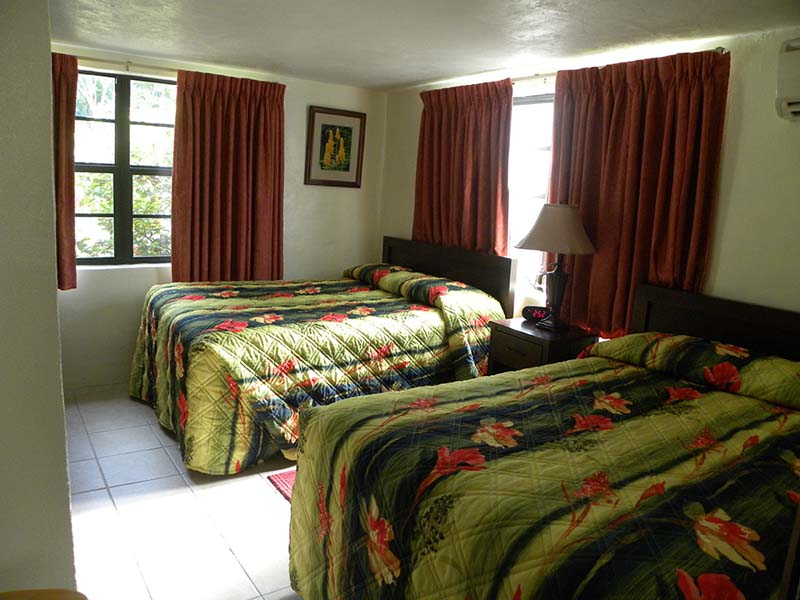 Guest room with two double beds.