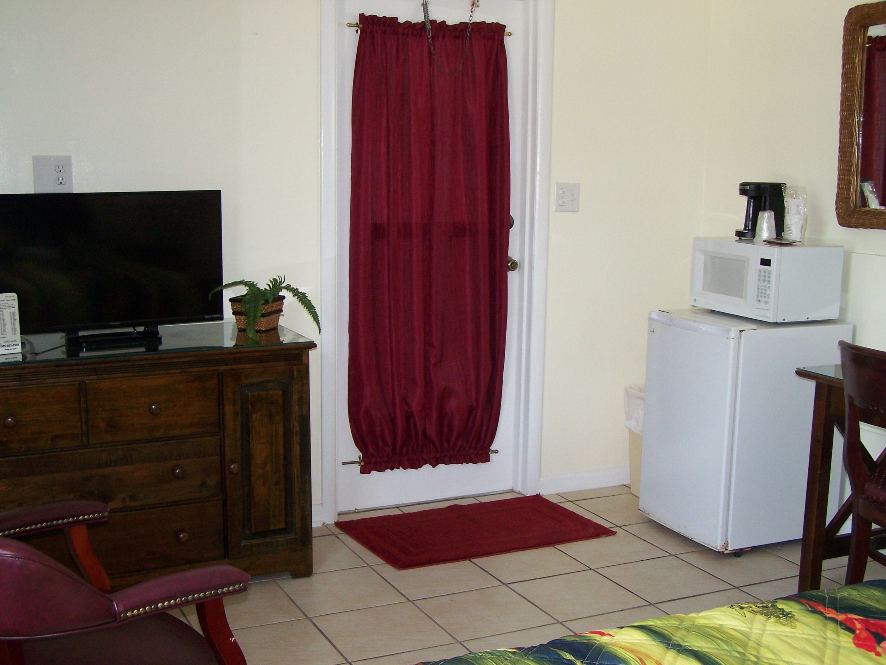Guest room with kitchenette and TV.